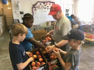 2018 Mission and Massanetta Team working in VA Food Pantry