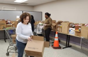 Broad Street Food Pantry volunteers putting together boxes of food for patrons.